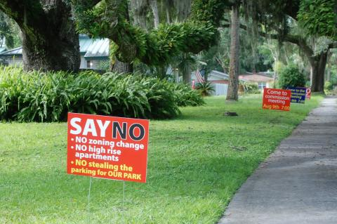 Residents put up signs throughout Sanford urging citizens to attend the commission meeting about the apartment complex.