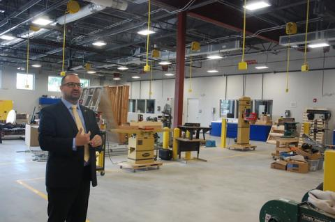 Lyman Principal Michael Hunter shows off classrooms for welding and HVAC as well as building construction instruction.