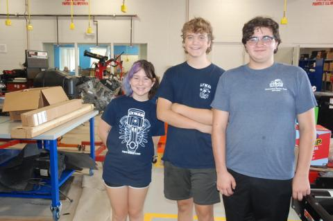 From left, sophomore Cody Comes and seniors Alrik Anderson and Joseph Toscano volunteered Monday to help ready the new CTE Building for the opening of the school year next Tuesday, Aug. 10.