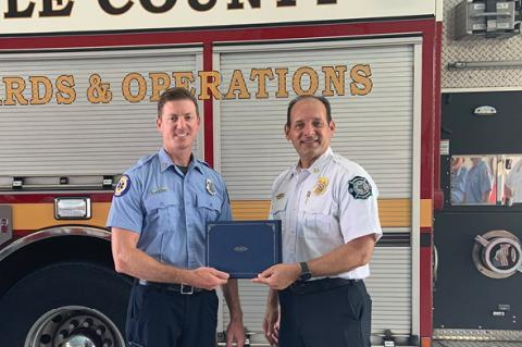 Firefighter/Paramedic Brad Dickey (left) with Seminole County Fire Chief Otto Drozd III.