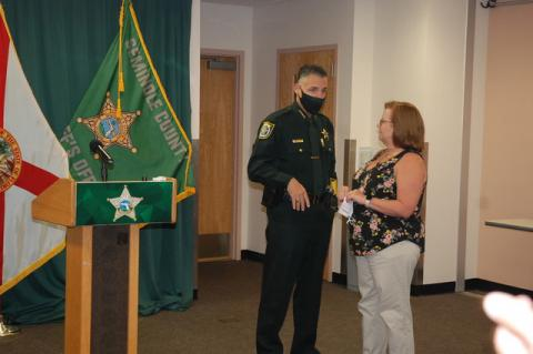 Sheriff Dennis Lemma talks with Nancy Ackerman, whose daughter died of an overdose of heroin laced with Fentanyl.